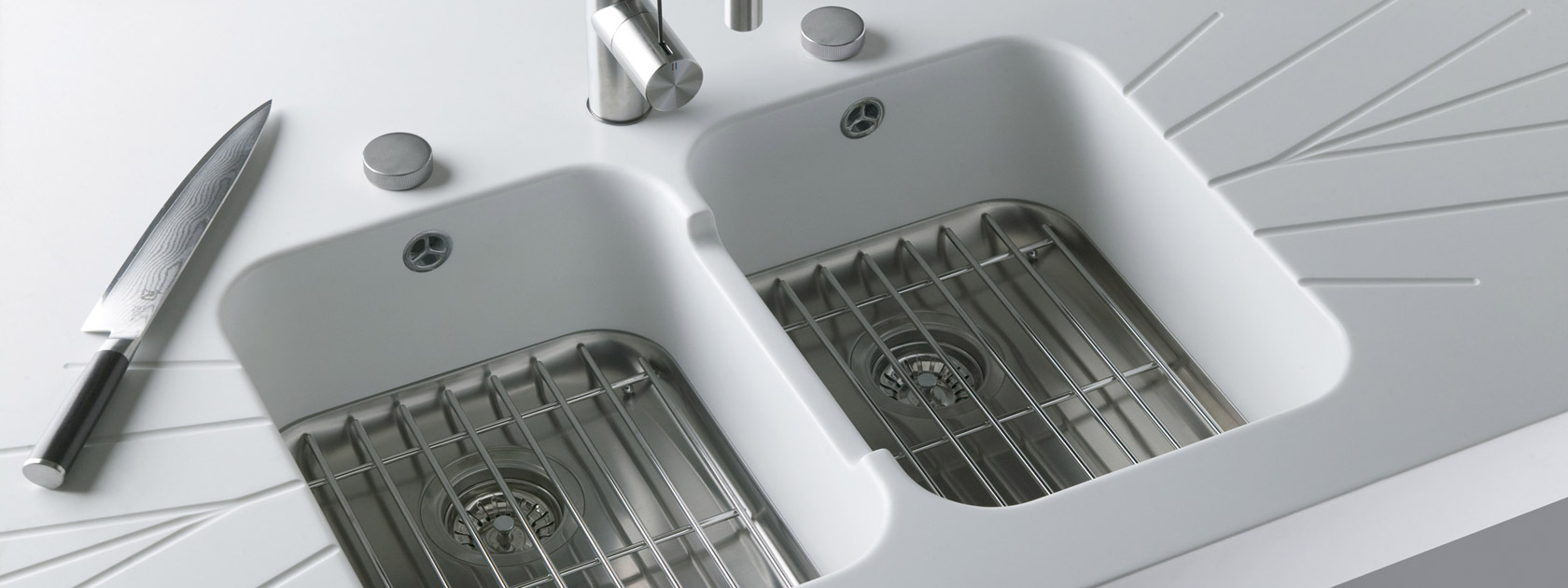 MIXA Sinks, seamless stainless steal flow from your Corian worktop
